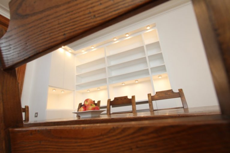 Wood table with white light storage behind