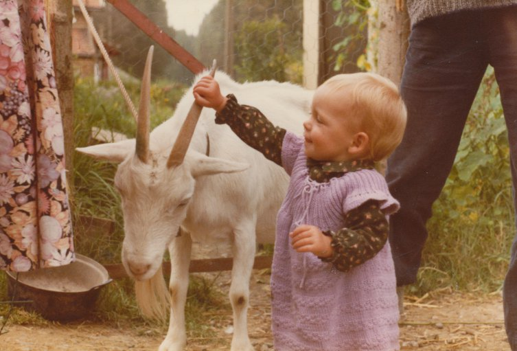 Girl playing with goat