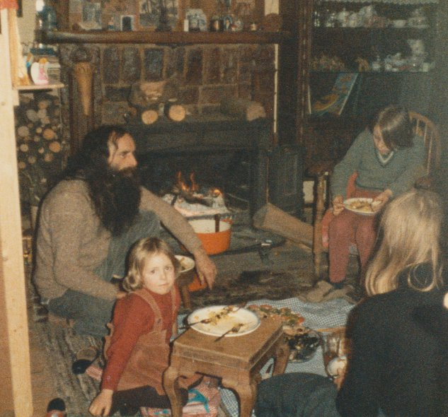 Familly eating special diner in front of open fire