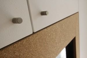 Close up of metal handles on a cupboard.