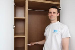 Tristan Titeux standing infront of an open cupboard