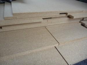 Pieces of cut Strawboard.
