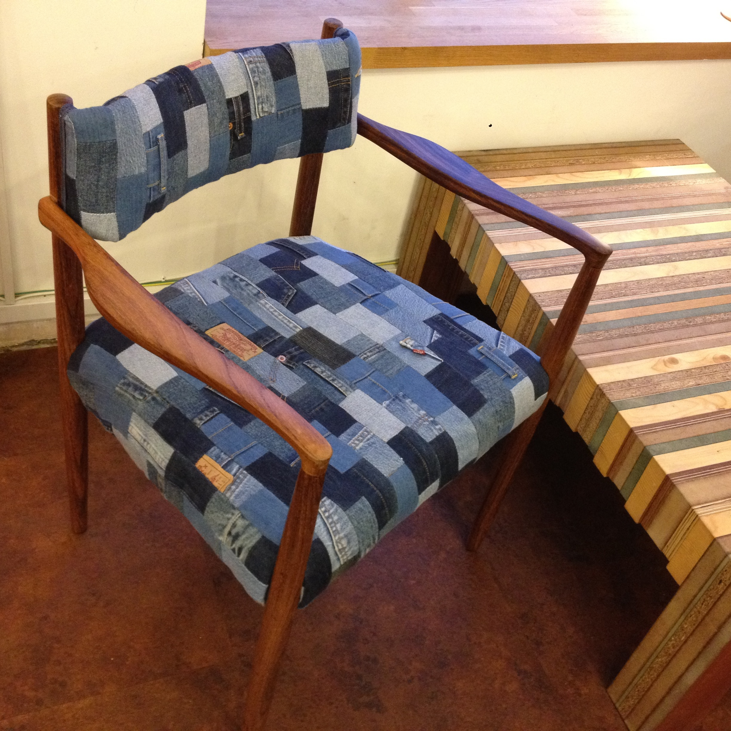 This Chair is upcycled in London using a well built, quality chair using old jeans. The chair is ready for another lifetime. Made by Emma Phelps.