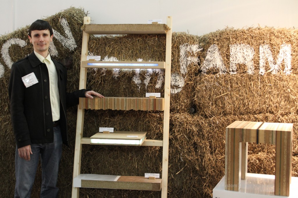 Tristan Titeux standing next to his eco shelves made of sustainable materials