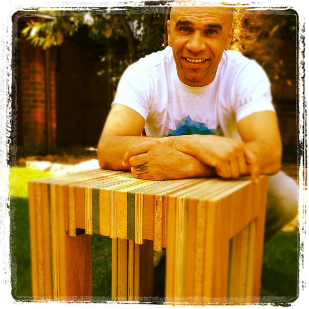 DJ Goldie with the Milo table made form upcycled waste wood.